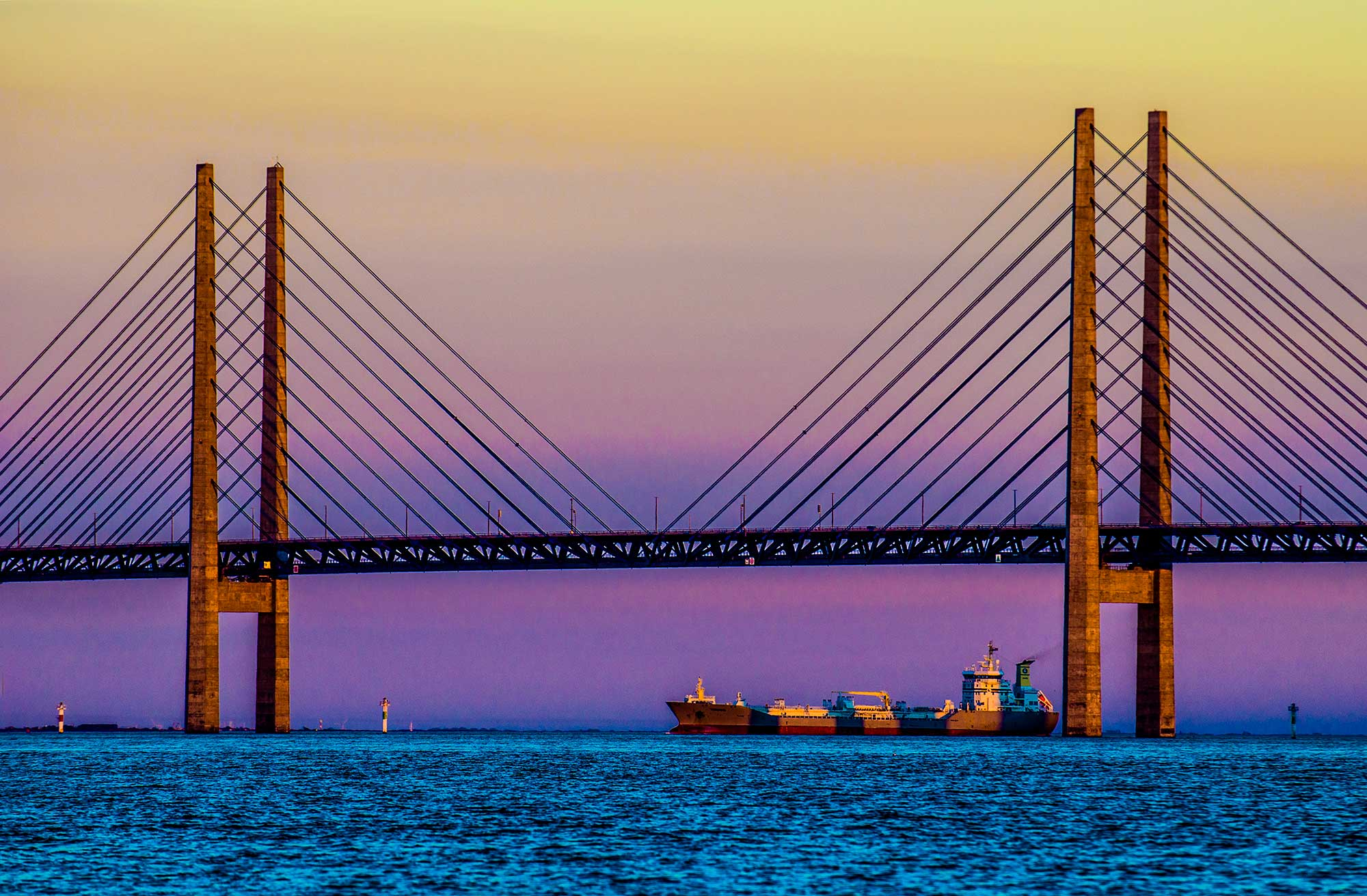 Oresund bridge, ship in sunset. closeup